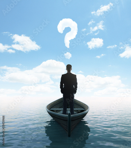 businessman standing on a boat