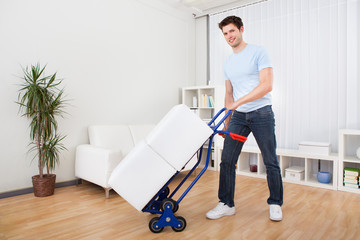 Young Man With Box On Trolley