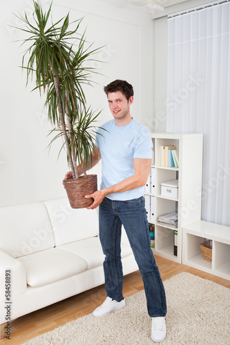 Young Man Holding Plant