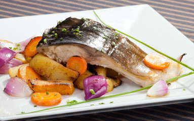 Grilled carp with vegetable garnish