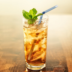 golden iced tea with blue straw and mint © Joshua Resnick