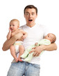 Shocked young man with two babies over white
