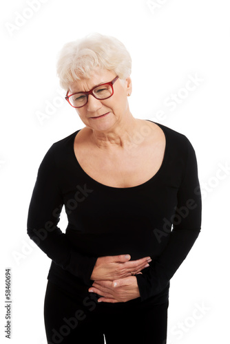 An old lady is having a stomachache.