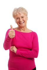 An old woman wearing pink shirt, showing OK.