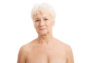 Portrait of nude old woman- head and shoulders.