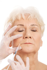 An old woman having a injection- beauty concept.
