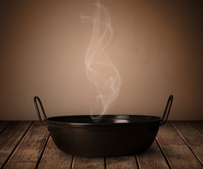 pot on old wooden table