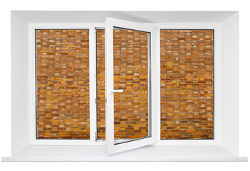 White plastic cutout triple door window with brick wall inside