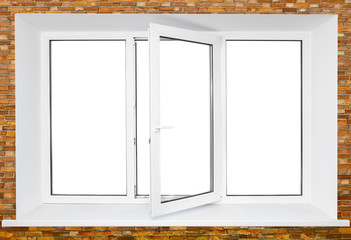 White plastic triple door window on brick wall with cutout area