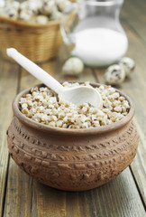 Buckwheat porridge, milk and quail eggs