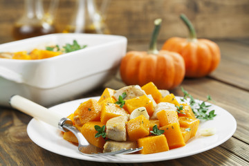 Baked pumpkin with chicken. garlic and herbs
