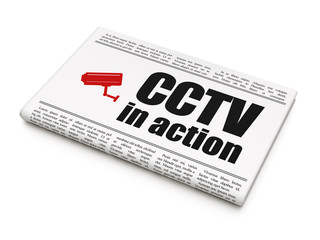 Safety news concept: newspaper with CCTV In action