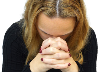 A young woman praying with her hands together on white backgroun