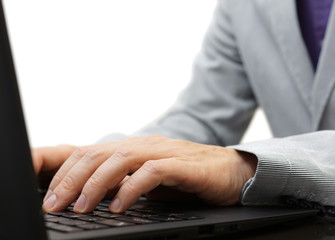 businessman typing text on a laptop keyboard
