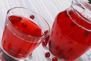 a refreshing drink from the berries of red cranberries in a jug