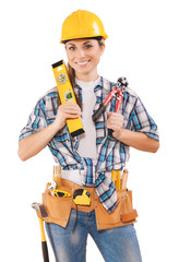 beautiful female worker holding tools