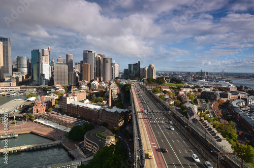 View of the business center of Sydney with the Harbour Bridge.