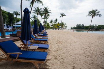 Deck chairs on the beach of Sentosa Island in Singapore.