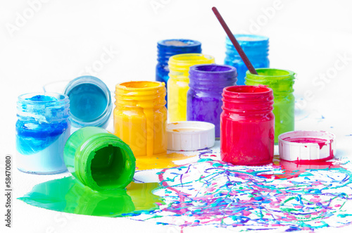 Used and spilled plastic paint bottles