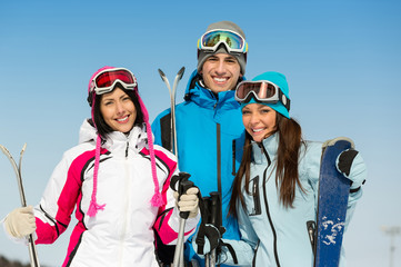 Half-length portrait of group of skier friends