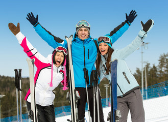 Half-length portrait of group of downhill skier friends