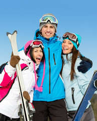 Half-length portrait of group of hugging downhill skier friends