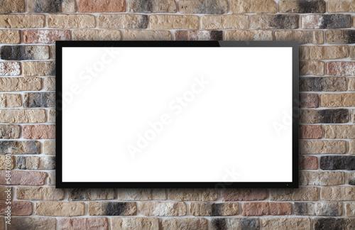 Leinwanddruck Bild TV display on brick wall