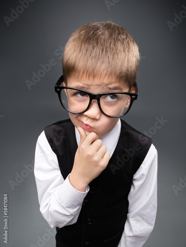 Wide angle portrait of little businessmen in spectacles