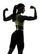 woman exercising fitness flexing muscles silhouette rear view