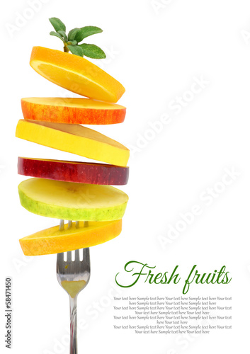 Fresh slices of fruits on a fork