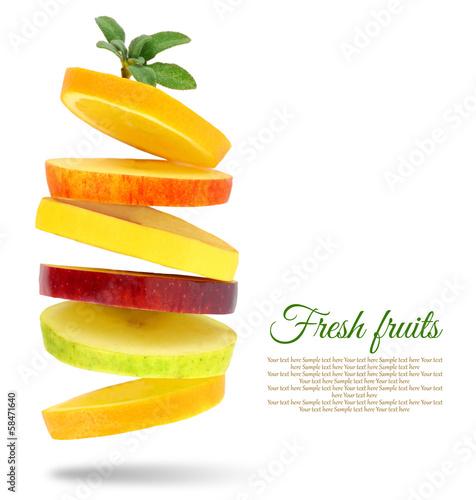 Fotobehang Vruchten Fresh slices of fruits