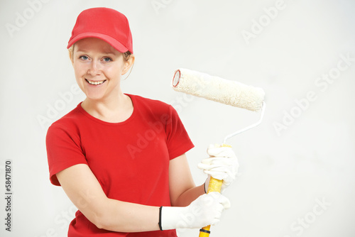 woman painter worker with roller