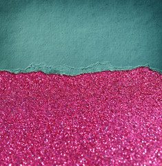 pink glitter background and blue vintage torn paper