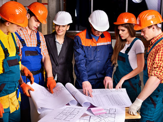 Business group people in builder helmet .