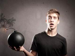 young man holding a bomb
