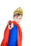 Beautiful funny child dressed as king with a crown commanding