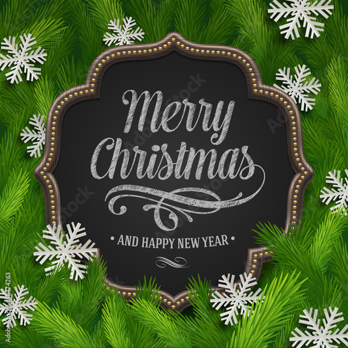 Chalkboard with christmas greeting and paper snowflakes