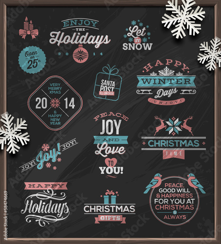 Christmas holidays signs, emblems and greetings on a chalkboard