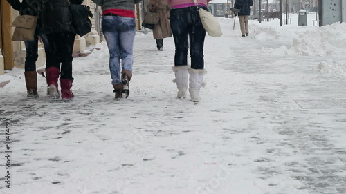 People Walking on Snowy Street