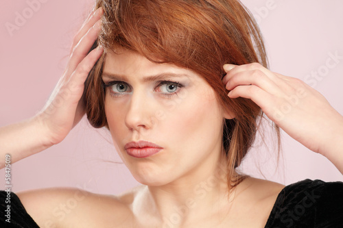 Woman in dilemma holding head