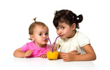 little girls with glass of orange juice