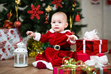 Christmas baby girl with lamp