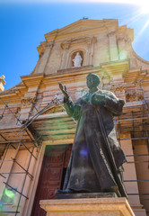 Pope John Paul II statue at Gozo Cathedral with artistic flares
