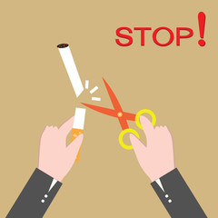 Stop smoking, human hands cutting the cigarette