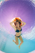 Underwater woman back light portrait in swimming pool.