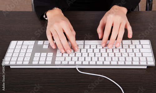 Businesswoman using keyboard