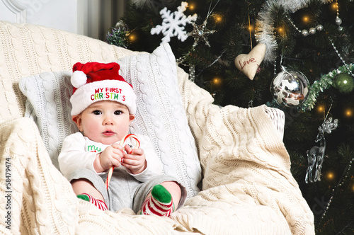 New year baby under the christmas tree