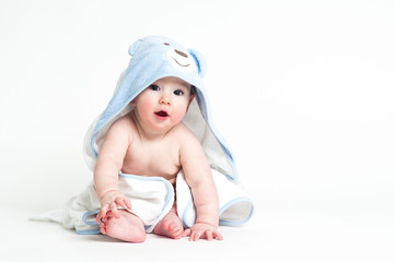 cute baby in a towel isolated on white background