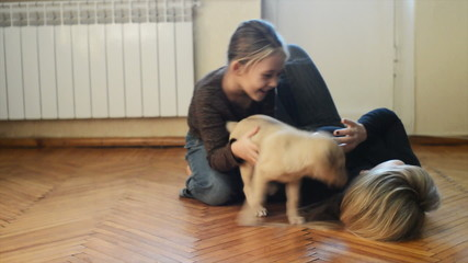 girls play with dogs