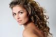 Beautiful brunette woman with curls